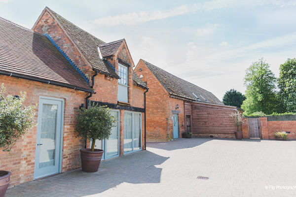 The Bridge barn and courtyard at Bassmead Manor Barns wedding venue in Cambridgeshire | CHWV