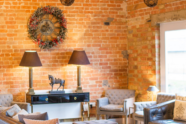 A chill out area in the Moat Barn at Bassmead Manor Barns wedding venue in Cambridgeshire | CHWV