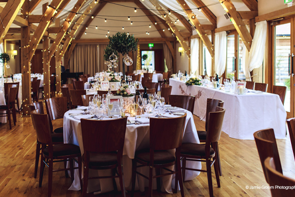 Set up for a wedding reception at Bassmead Manor Barns wedding venue in Cambridgeshire | CHWV