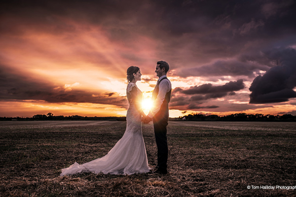 A couple taking a moment at Bassmead Manor Barns wedding venue in Cambridgeshire | CHWV