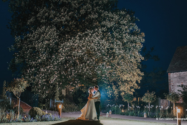 A couple taking a moment in the evening at Bassmead Manor Barns wedding venue in Cambridgeshire | CHWV
