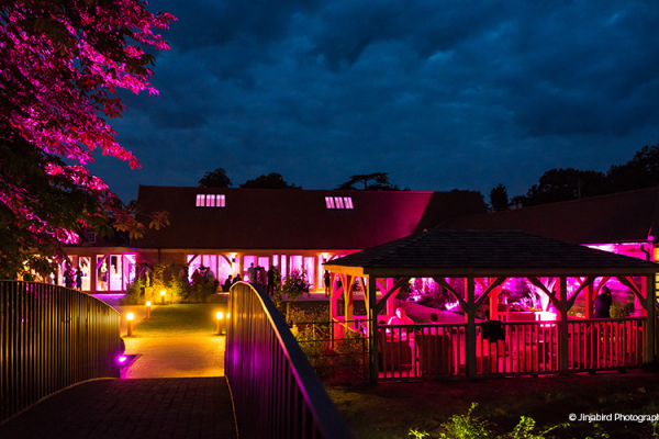 Bassmead Manor Barns wedding venue in Cambridgeshire lit up in the evening | CHWV