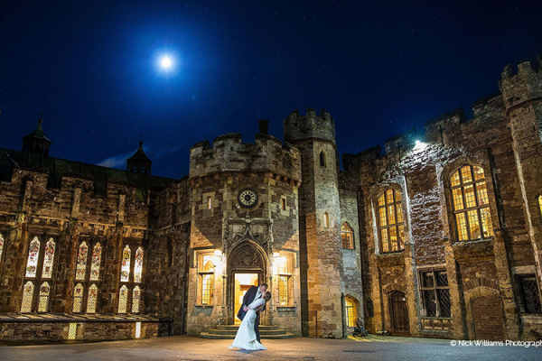 A couple taking a moment in the evening outside Berkeley Castle wedding venue in Gloucestershire | CHWV