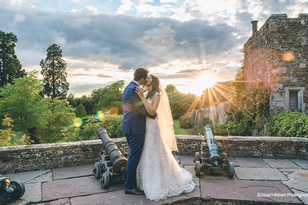 A couple taking a moment as the sun is setting at Berkeley Castle wedding venue in Gloucestershire | CHWV