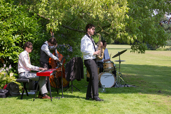 A band provide entertainment at Berkeley Castle wedding venue in Gloucestershire | CHWV