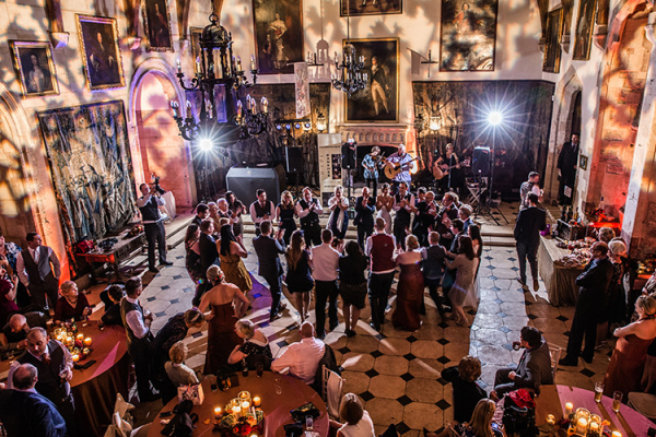Guests enjoying the evening wedding celebration at Berkeley Castle wedding venue in Gloucestershire | CHWV