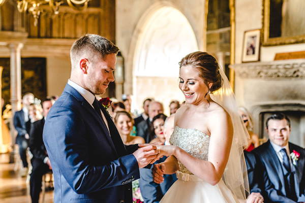 Exchanging rings in a romantic ceremony at Berkeley Castle wedding venue in Gloucestershire | CHWV