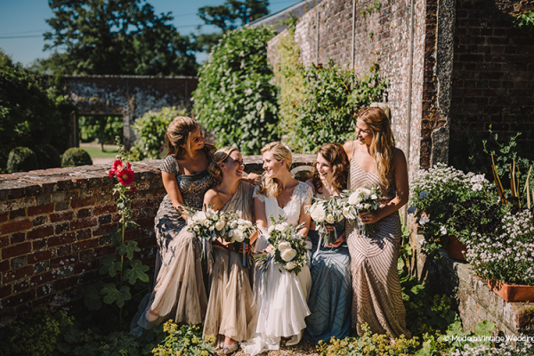 A bride and her bridesmaids at Bignor Park wedding venue in West Sussex | CHWV