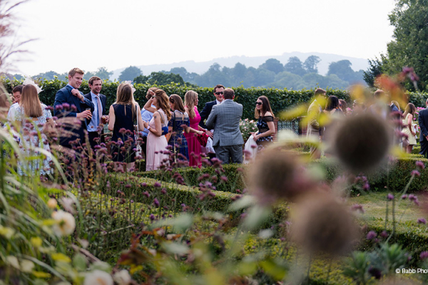 A drinks reception in the beautiful gardens at Bignor Park wedding venue in West Sussex | CHWV