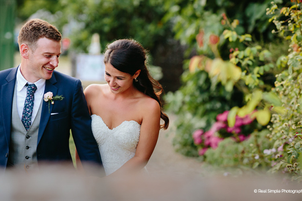 A romantic stroll in the beautiful gardens at Bignor Park wedding venue in West Sussex | CHWV