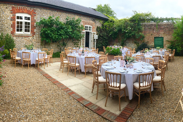 Set up for an outdoor wedding breakfast at Bignor Park wedding venue in West Sussex | CHWV