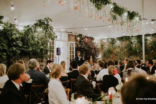 Guests at a wedding breakfast at Bignor Park wedding venue in West Sussex | CHWV