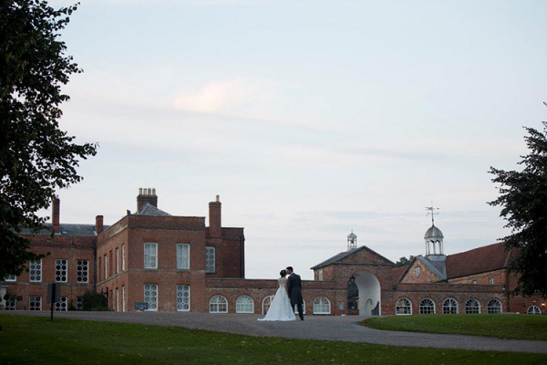 A happy couple in the grounds at Braxted Park in Essex | CHWV