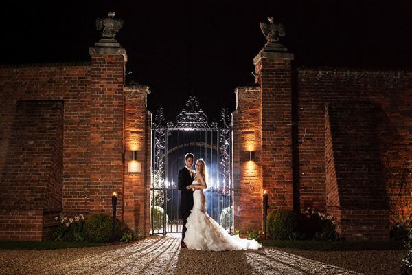 A happy couple in the grounds of Braxted Park in Essex at night | CHWV