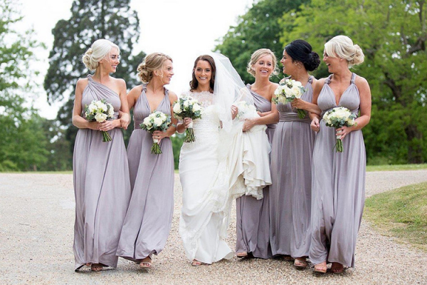 A bride and her bridesmaids in the grounds of Braxted Park in Essex | CHWV