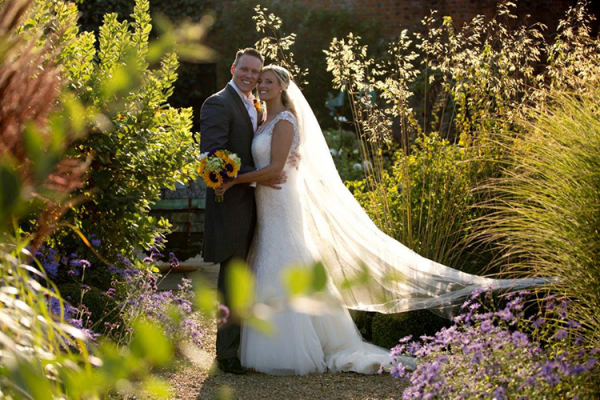 A couple in the beautiful grounds at Braxted Park in Essex | CHWV