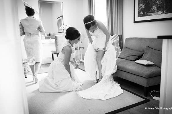 A bride getting ready at Braxted Park country house wedding venue in Essex | CHWV