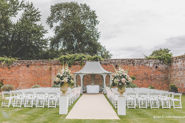 Set up for an outdoor wedding ceremony at Braxted Park country house wedding venue in Essex | CHWV
