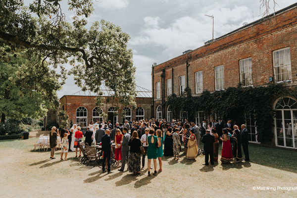 A drinks reception in the courtyard at Braxted Park country house wedding venue in Essex | CHWV