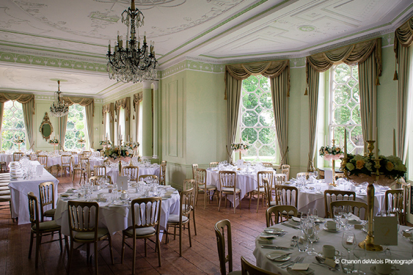 Set up for a wedding breakfast in the house at Braxted Park country house wedding venue in Essex | CHWV
