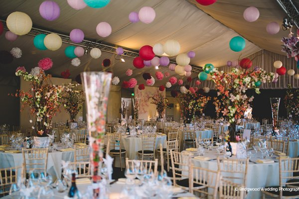 Bright paper lanterns in the pavilion at Braxted Park country house wedding venue in Essex | CHWV