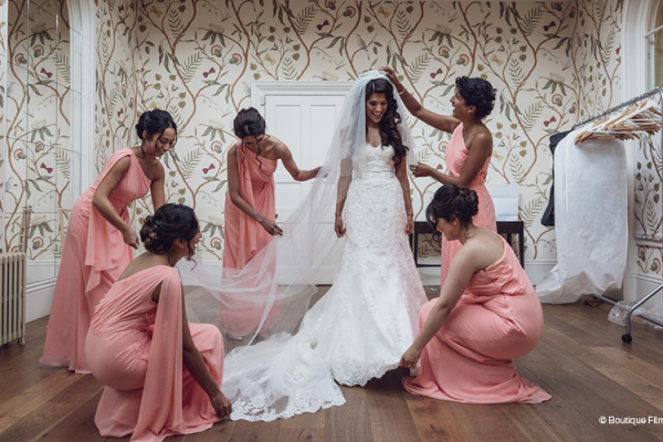 A bride and her bridesmaids getting ready at Braxted Park wedding venue in Essex | CHWV