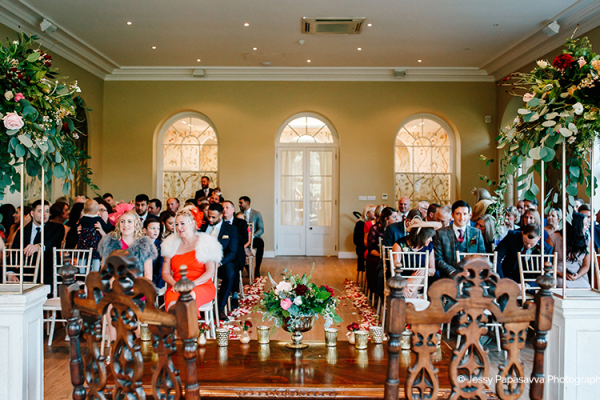 A wedding ceremony in the Ballroom at Braxted Park wedding venue in Essex | CHWV