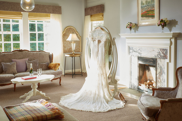 Getting ready in the honeymoon suite at Brinsop Court country house wedding venue in Herefordshire | CHWV