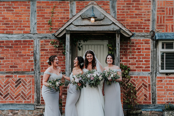 A bride and her bridesmaids at Brinsop Court country house wedding venue in Herefordshire | CHWV