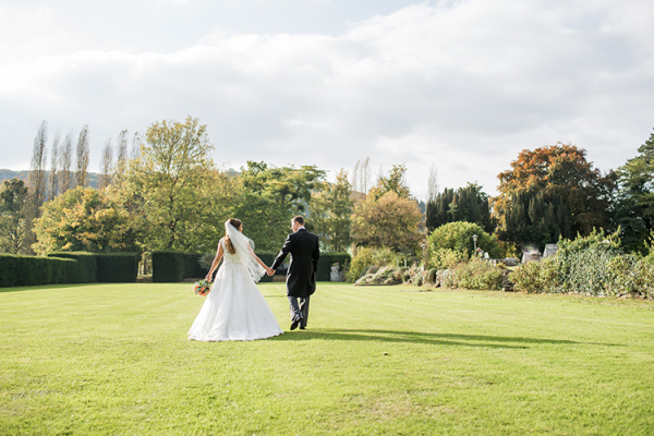 A couple taking a moment in the beautiful grounds at Brinsop Court country house wedding venue in Herefordshire | CHWV