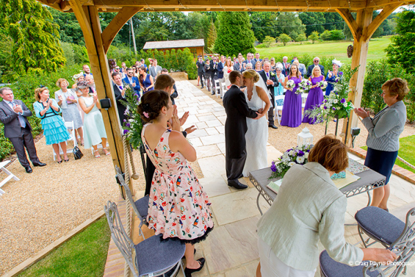 An outdoor wedding ceremony at Brookfield Barn wedding venue in West Sussex | CHWV
