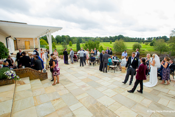 An outdoor wedding drinks reception at Brookfield Barn wedding venue in West Sussex | CHWV