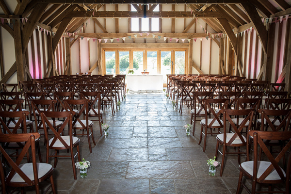 Set up for a wedding ceremony at Brookfield Barn wedding venue in West Sussex | CHWV