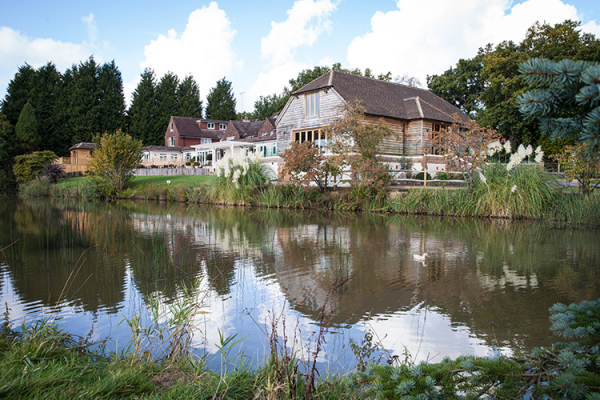 The grounds and lake at Brookfield Barn wedding venue in West Sussex | CHWV
