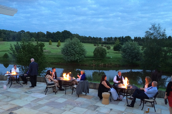The firepits in the courtyard at Brookfield Barn wedding venue in West Sussex | CHWV