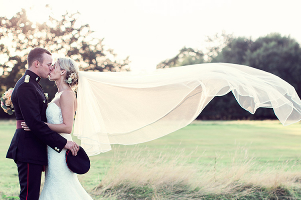 A happy couple in the grounds at Brookfield Barn wedding venue in West Sussex | CHWV