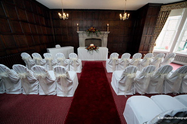 Set up for a ceremony at Brooksby Hall wedding venue in Leicestershire | CHWV