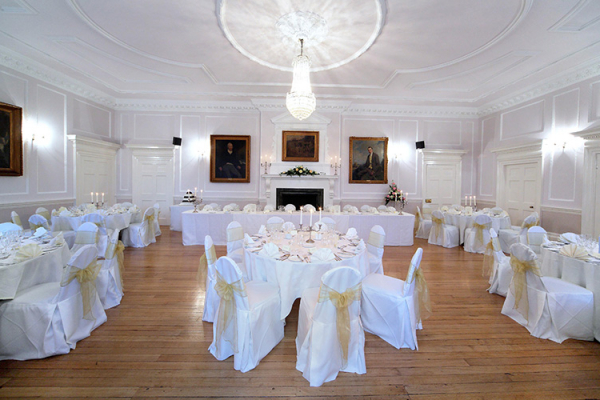 Old Hall set up for a wedding breakfast at Brooksby Hall wedding venue in Leicestershire | CHWV