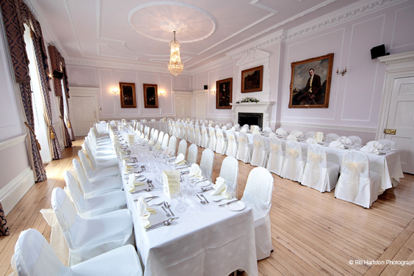 Brooksby Hall wedding venue in Leicestershire set up for a reception | CHWV