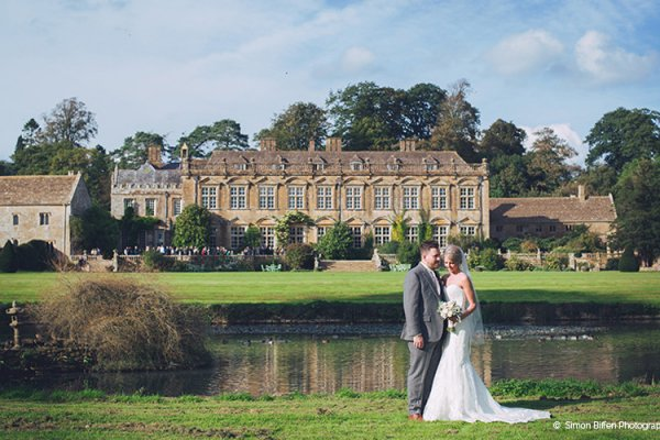 Happy couple with Brympton House in the background