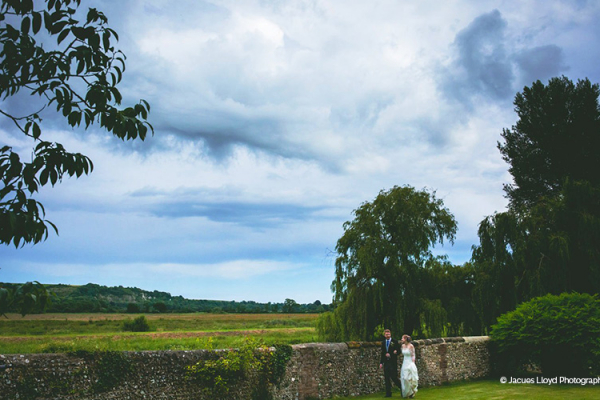 A happy couple taking a moment at Bury Manor Barn wedding venue in West Sussex | CHWV