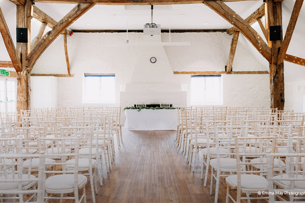 Set up for a wedding ceremony at Bury Manor Barn wedding venue in West Sussex | CHWV