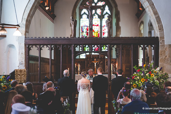 Romantic wedding ceremony in the church nearby at Bury Manor Barn wedding venue in West Sussex | CHWV