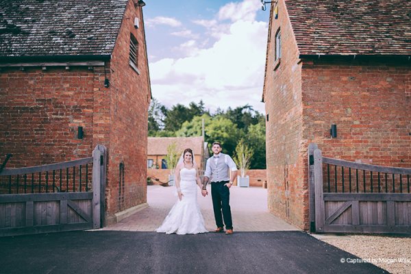 Bride-and-groom-in-the-courtyard-at-Bassmead-Manor-Barns