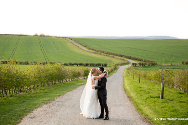 A happy couple taking a stroll at Clock Barn in Hampshire