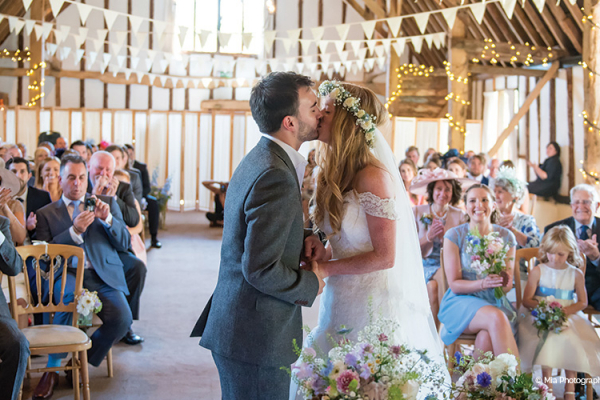 A wedding ceremony at Clock Barn in Hampshire