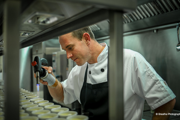 A Galloping Gourmet chef at work at Clock Barn in Hampshire