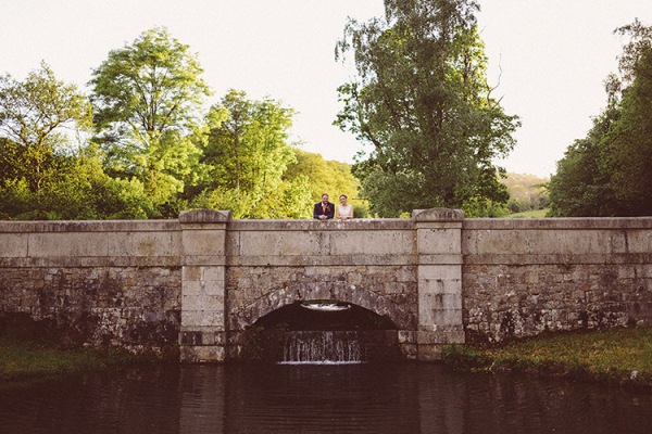 A happy couple on the bridge at Colehayes Park wedding venue in Devon | CHWV