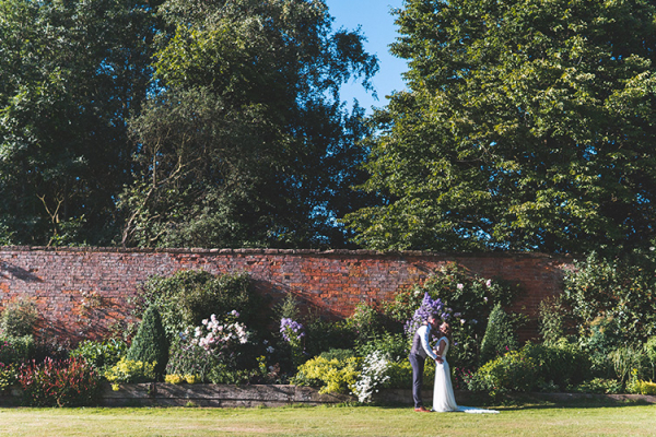 A happy couple taking a moment at Crockwell Farm wedding venue in Northamptonshire | CHWV
