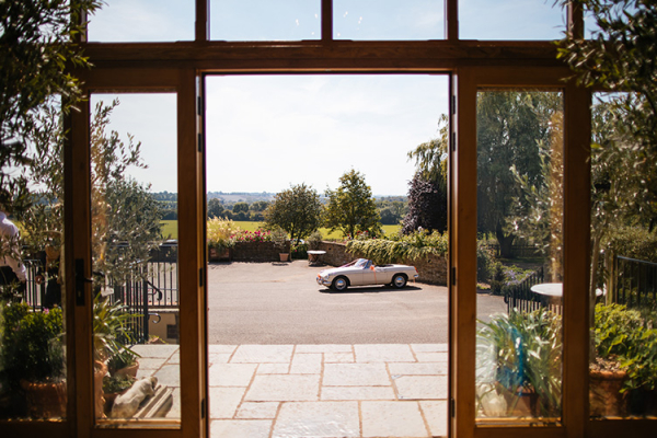 Wedding transport in the courtyard at Crockwell Farm wedding venue in Northamptonshire | CHWV